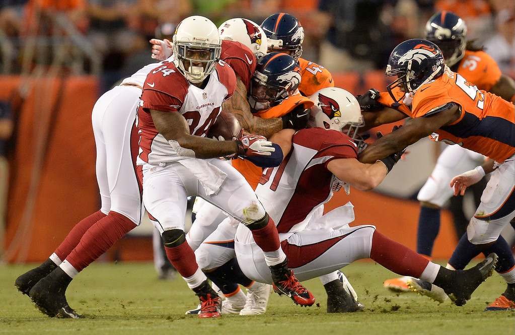 . Arizona Cardinals running back Ryan Williams (34) spins free as Arizona Cardinals tight end Kory Sperry (83) pancakes Denver Broncos defensive back Ross Rasner (41) during the first half on August 29, 2013 at Sports Authority Field at Mile High. The Denver Broncos hosted the Arizona Cardinals in the final game of the preseason. (Photo by John Leyba/The Denver Post)