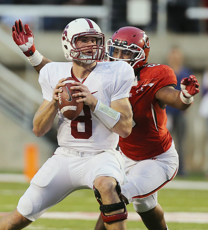 . SALT LAKE CITY, UT - OCTOBER 12: Quarterback Kevin Hogan #8 of the Stanford Cardinal gets ready to be sacked by Nate Orchard #8 the Utah Utes during the second half of an NCAA football game October 12, 2013 at Rice Eccles Stadium in Salt Lake City, Utah. Utah Beat Stanford 27-21. (Photo by George Frey/Getty Images)
