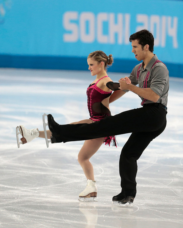 Description of . Paige Lawrence and Rudi Swiegers of Canada compete in the pairs short program figure skating competition at the Iceberg Skating Palace during the 2014 Winter Olympics, Tuesday, Feb. 11, 2014, in Sochi, Russia. (AP Photo/Ivan Sekretarev)