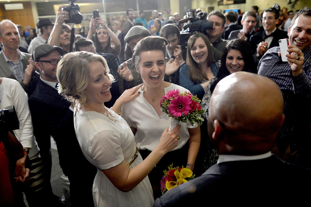 . DENVER, CO. - APRIL 30: Sonja Semion and Courtney Law join in a civil union ceremony lead by Mayo Michael Hancock at the Webb Building in  Denver CO, April 30, 2013.  The Clerk and Recorder\'s Office opened for business from midnight to 3 a.m. to issue civil union licenses to couples on May 01, 2013 when the Civil Union Act became law.  (Photo By Craig F. Walker/The Denver Post)