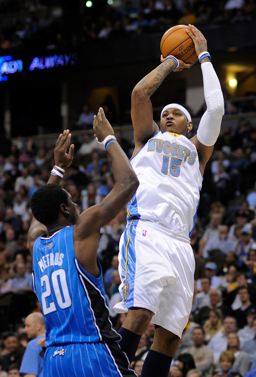 . 2003: Carmelo Anthony (No. 3) Carmelo Anthony (15) put up a jumper over Magic forward Mickael Pietrus (20) in the fourth quarter.  The Colorado Nuggets defeated the Orlando Magic 115-97 Wednesday night, January 14, 2010 at the Pepsi Center.      Karl Gehring, The Denver Post