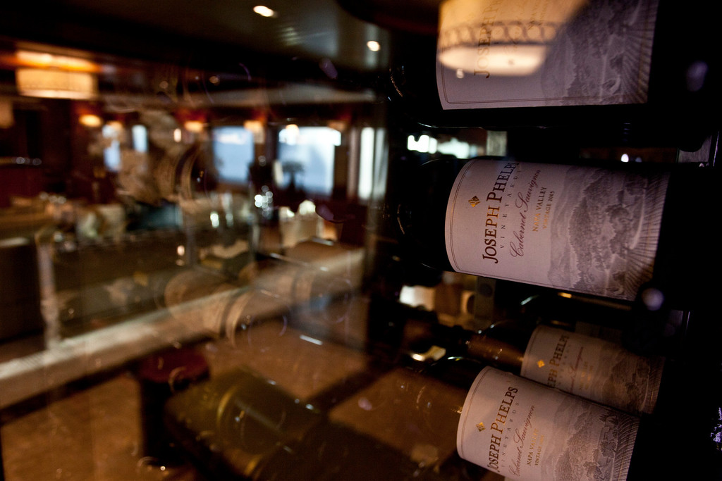 . Bottles of red wine sit stored in a wine cellar onboard the 190ft (57.9m) motor yacht Mi Sueno, manufactured by Trinity Yachts LLC, in Nice, France, on Wednesday, Sept. 25, 2013. Photographer: Balint Porneczi/Bloomberg
