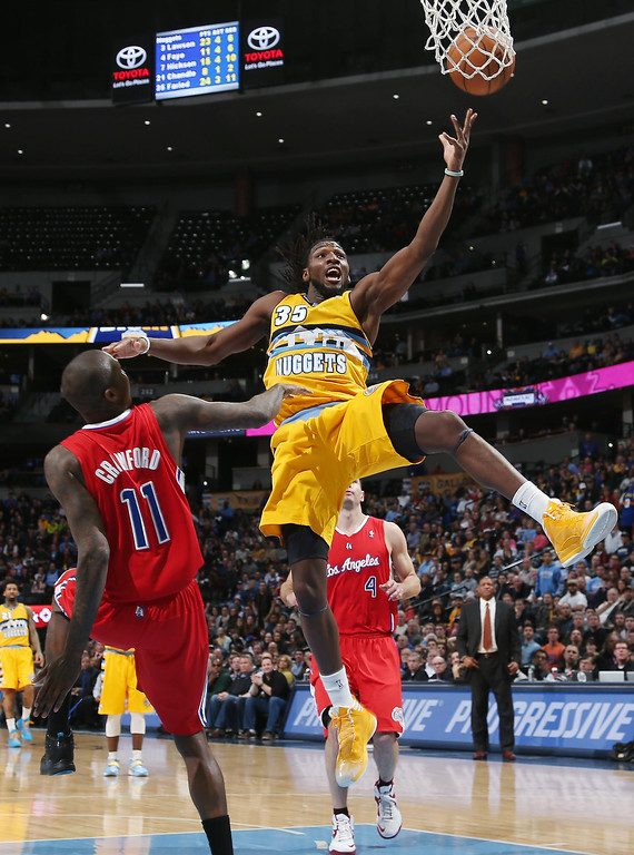 . Denver Nuggets forward Kenneth Faried, right, is fouled as he drives lane for shot by Los Angeles Clippers guard Jamal Crawford in the fourth quarter of the Nuggets\' 116-115 victory in an NBA basketball game in Denver on Monday, Feb. 3, 2014. (AP Photo/David Zalubowski)