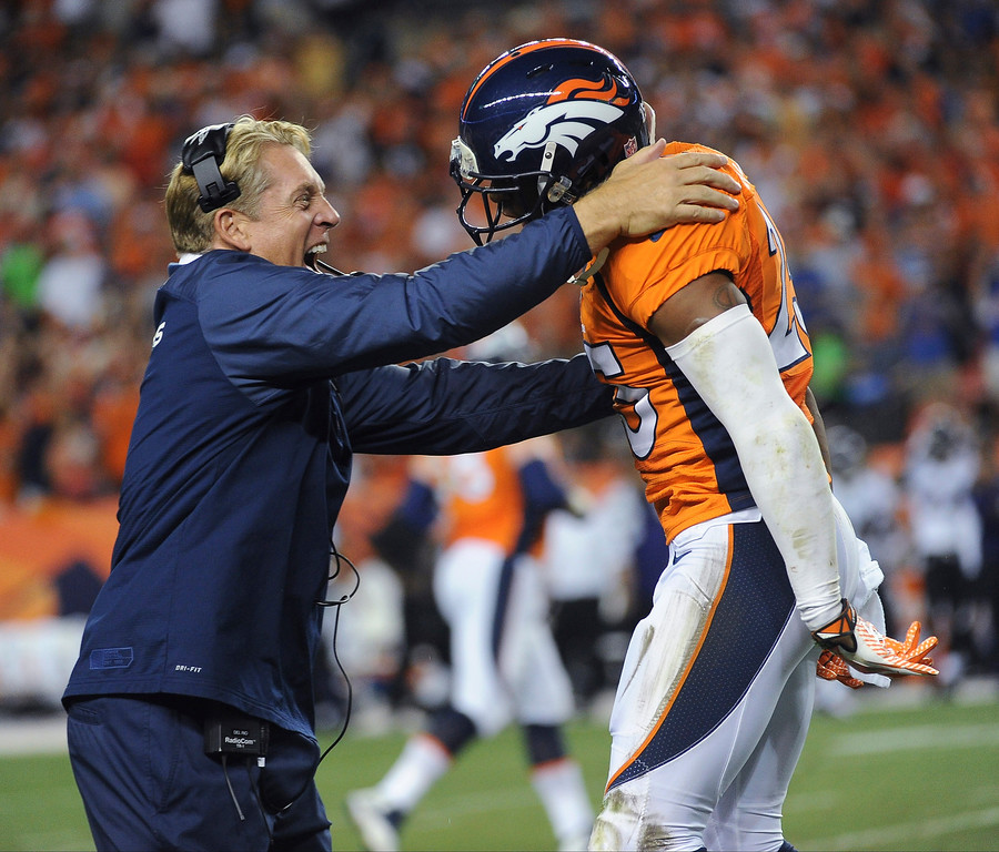 . Defensive coach Jack Del Rio celebrates Denver Broncos cornerback Chris Harris\'s (25) interception in the second quarter. The Denver Broncos took on the Baltimore Ravens in the first game of the 2013 season at Sports Authority Field at Mile High in Denver on September 5, 2013. (Photo by Tim Rasmussen/The Denver Post)