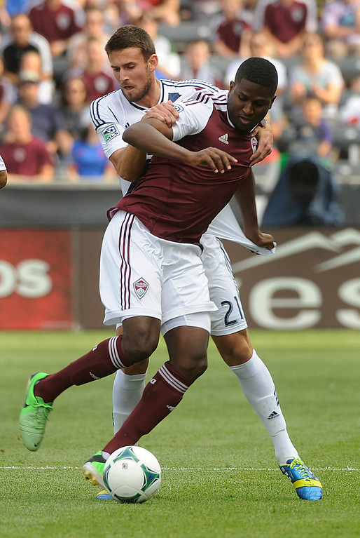 . COMMERCE CITY, CO. - JULY 27:  Galaxy defender Tommy Meyer (21) tried to pull Rapids forward Edson Buddle (9) off the ball in the first half. The Colorado Rapids hosted the Los Angeles Galaxy Saturday, July 27, 2013.  Photo By Karl Gehring/The Denver Post
