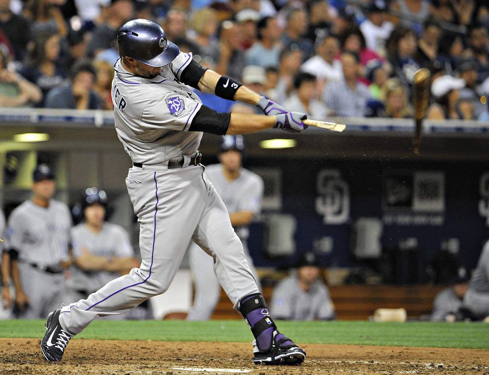 . SAN DIEGO, CA - SEPTEMBER 7:  Michael Cuddyer #3 of the Colorado Rockies breaks his bat as he grounds out during the sixth inning of a baseball game against the San Diego Padres at Petco Park on September 7, 2013 in San Diego, California.  (Photo by Denis Poroy/Getty Images)
