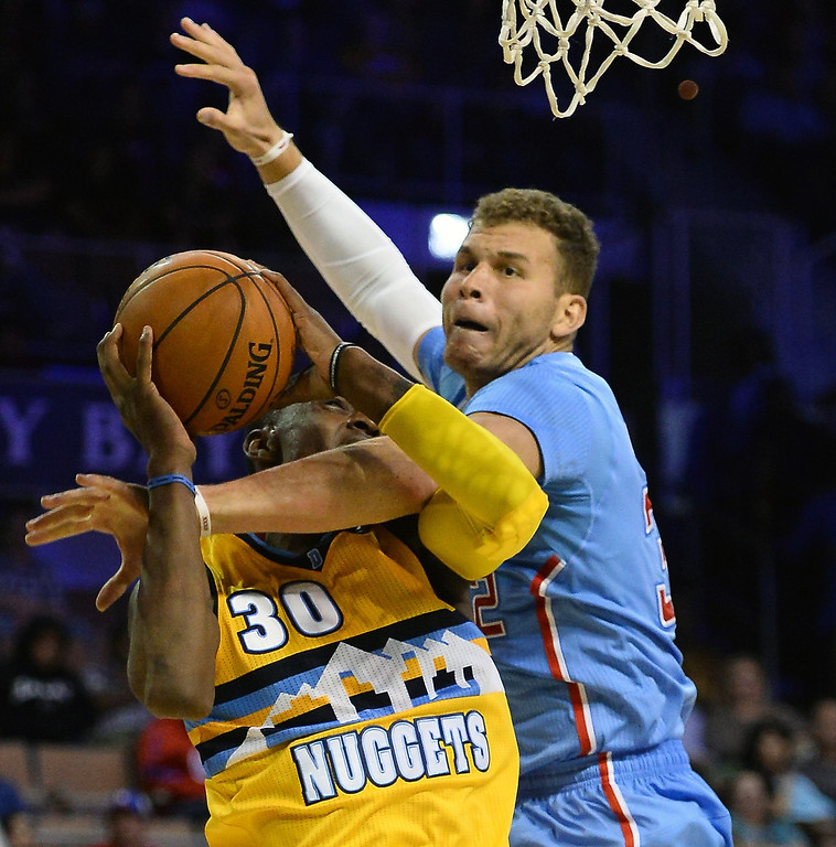 . Blake Griffin #32 of the Los Angeles Clippers fouls Quincy Miller #30 of the Denver Nuggets during their preseason game at the Mandalay Bay Events Center on October 19, 2013 in Las Vegas, Nevada. Los Angeles won 118-111 in overtime.   (Photo by Ethan Miller/Getty Images)