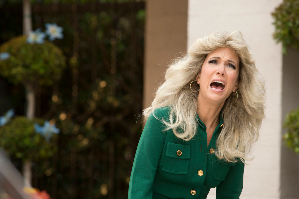 ". This image released by IFC TV shows Kristen Wiig as Cynthia Morehouse in a scene from ""The Spoils of Babylon.\"" Wiig was nominated for an Emmy Award for best actress in a miniseries or movie on Thursday, July 10, 2014. The 66th Primetime Emmy Awards will be presented Aug. 25 at the Nokia Theatre in Los Angeles. (AP Photo/IFC TV, Katrina Marcinowski)"