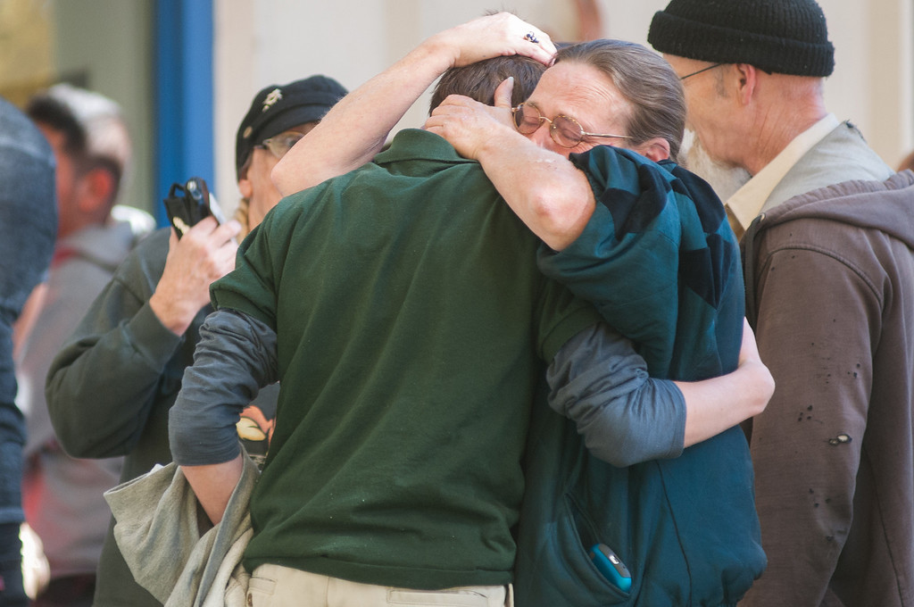 . A  Sparks Middle School student cries with family members after being released from Agnes Risley Elementary School, where some students were evacuated to after a shooting at Sparks Middle School in Sparks, Nev. on Monday, Oct. 21, 2013 in Sparks, Nev.   (AP Photo/Kevin Clifford)
