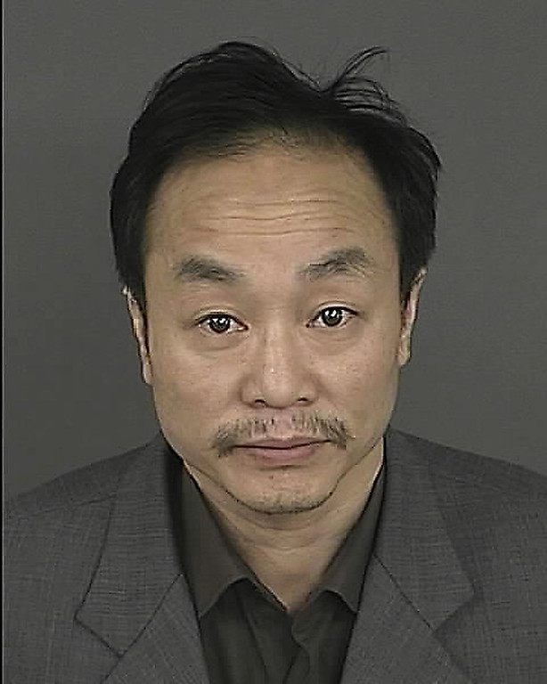 . Dejun Xu (D.O.B. 11-2-1965) One of three men charged with allegedly trying to sell a woman fake gold.