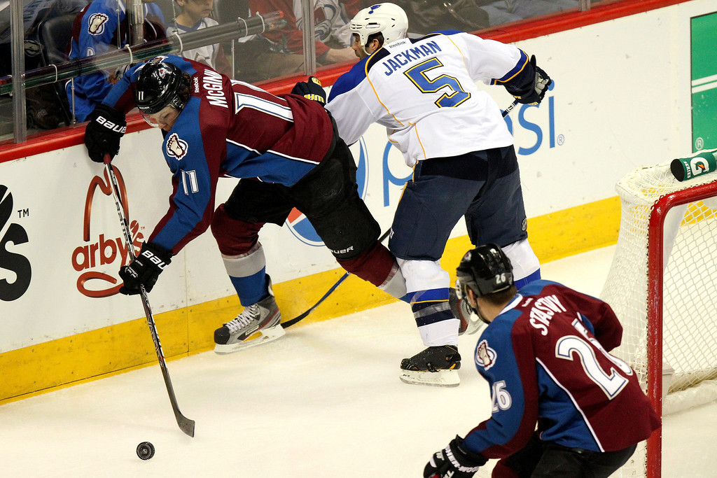 . Colorado Avalanche\'s Jamie McGinn (11) and St. Louis Blues\' Barret Jackman (5) battle for the puck during the first period of an NHL hockey game, Sunday, April 21, 2013, in Denver. The Avalanche won 5-3. (AP Photo/Barry Gutierrez)