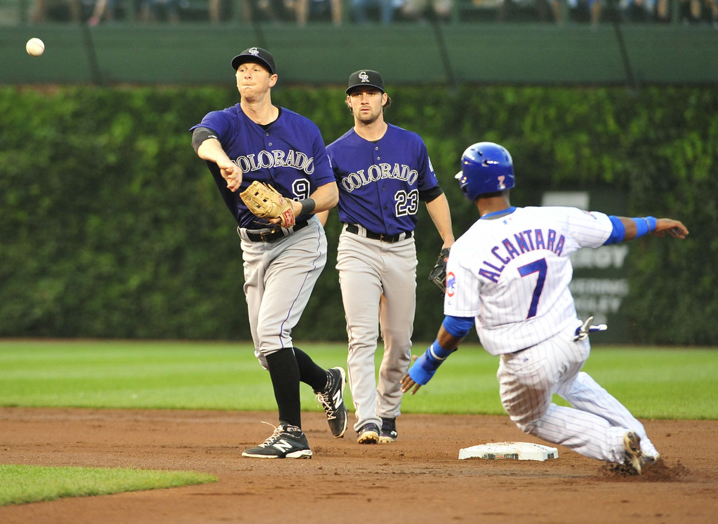 . CHICAGO, IL - JULY 30:  DJ LeMahieu #9 of the Colorado Rockies forces out Arismendy Alcantara #7 of the Chicago Cubs at second base during the first inning on July 30, 2014 at Wrigley Field in Chicago, Illinois. (Photo by David Banks/Getty Images)