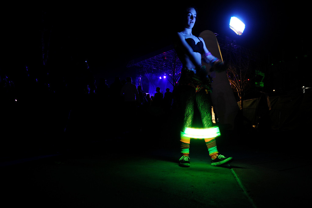 . DENVER, CO - APRIL 4: Kristan Black, 15, of Denver, twirls lights attached to strings as Knife Party performs during the Snowball Music Festival at Sports Authority Field at Mile High Stadium on April 4, 2014 in Denver, Colorado. The Snowball Music Festival is celebrating its first year in Denver after spending the previous three years as a mountain based festival. (Photo by Seth McConnell/The Denver Post)