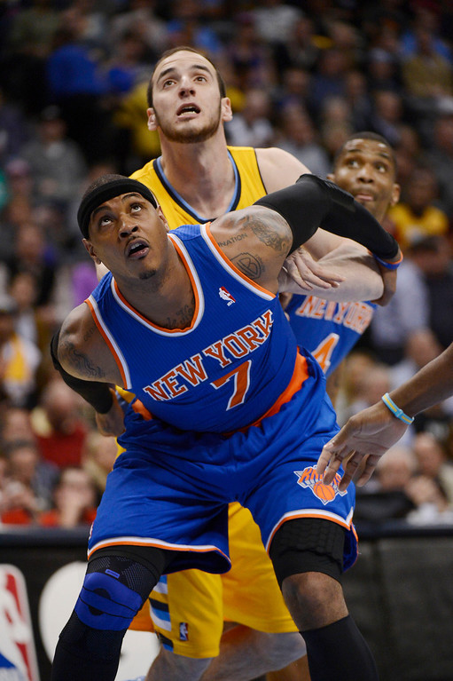 . Kosta Koufos (41) of the Denver Nuggets and Carmelo Anthony (7) of the New York Knicks battle for position during the first quarter  March 13,  2013 at Pepsi Center. (Photo By John Leyba/The Denver Post)