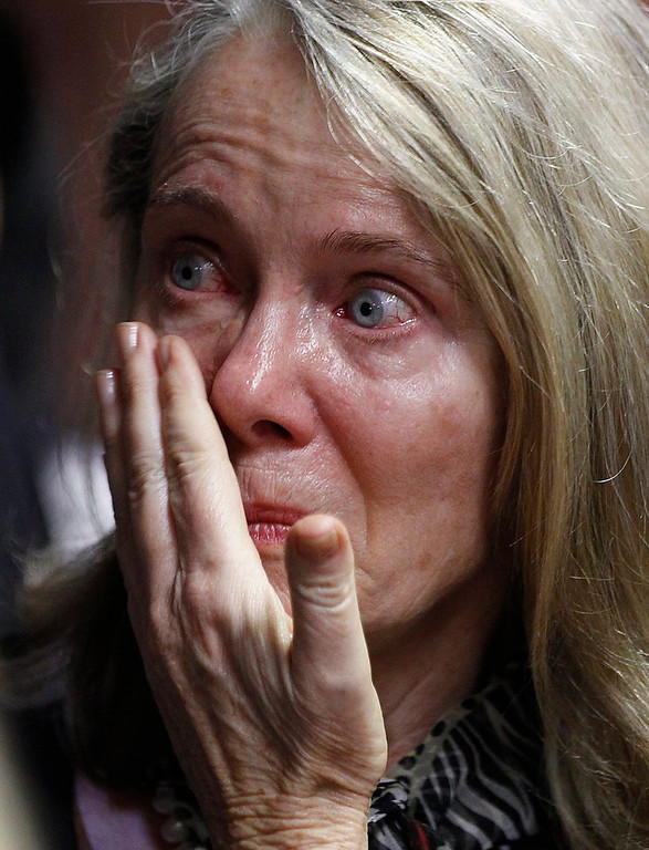 . A relative of Oscar Pistorius reacts at the end of his court appearance in the Pretoria Magistrates court, February 19, 2013. Pistorius, a double amputee who became one of the biggest names in world athletics, was applying for bail aftr being charged in court with shooting dead his girlfriend, 30-year-old model Reeva Steenkamp, in his Pretoria house. REUTERS/Siphiwe Sibeko