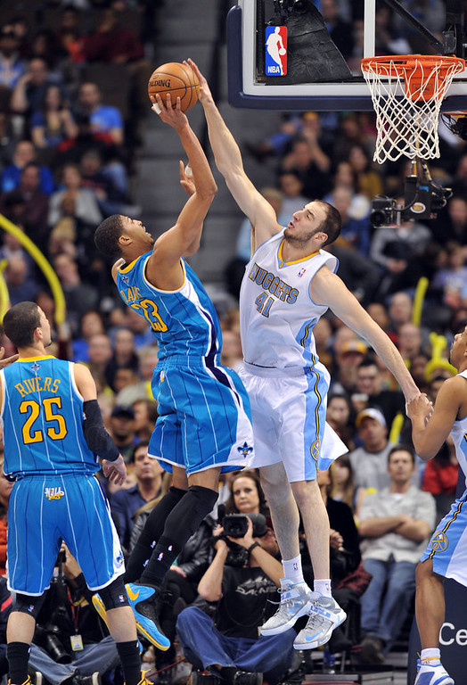 . DENVER, CO. - FEBRUARY 01: Kosta Koufos of Denver Nuggets #41 blocks the shot of Anthony Davis of New Orleans Hornets #23 in the 2nd half of the game on February 1, 2013 at the Pepsi Center in Denver, Colorado. Denver won 113-98. (Photo By Hyoung Chang/The Denver Post)