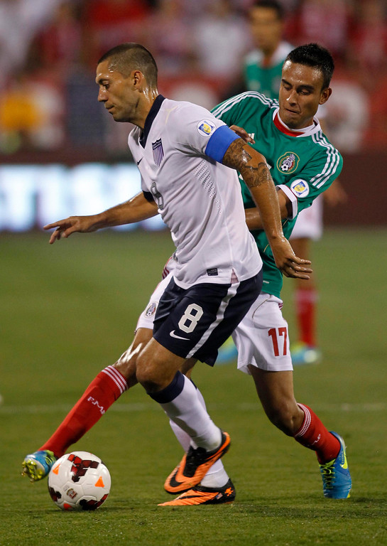 . Jesus Zavala (R) of Mexico and Clint Dempsey of USA fight for the ball during their Brazil 2014 FIFA World Cup qualifier at Columbus Crew Stadium in Columbus, Ohio, September 10, 2013.  AFP PHOTO / PAUL VERNONPaul VERNON/AFP/Getty Images