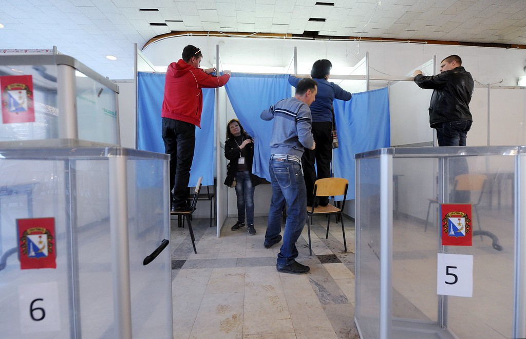 . Employees prepare the polling booth in one of the polling stations of Sevastopol on March 15, 2014, on the eve of the referendum in Crimea. Ukraine braced on Saturday for a breakaway vote in Crimea as deadly violence flared again in the  ex-Soviet country\'s tinderbox east amid the biggest East-West showdown since the Cold War. Tensions have spiralled in the region ahead of Sunday\'s vote in Ukraine\'s southern peninsula of Crime on whether to secede from Kiev and switch to Kremlin rule. AFP PHOTO/ VIKTOR  DRACHEV/AFP/Getty Images