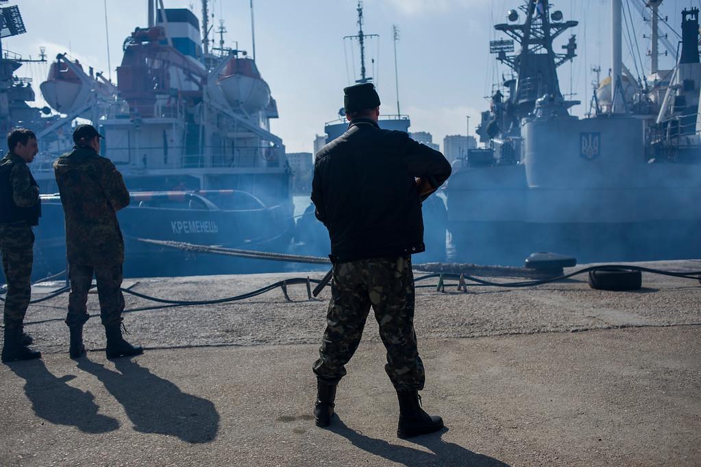 . Men in unmarked uniforms stand guard during seizure of the Ukrainian corvette Khmelnitsky in Sevastopol, Crimea, Thursday, March 20, 2014.  (AP Photo/Andrew Lubimov)