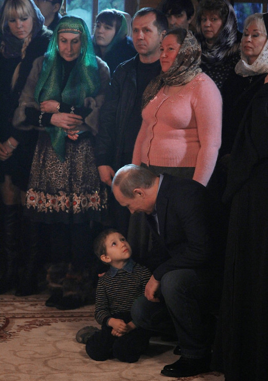 . Russian President Vladimir Putin attends a Christmas service in a church in Sochi early on January 7, 2013. Orthodox Christians celebrate Christmas on January 7 in the Middle East, Russia and other Orthodox churches that use the old Julian calendar instead of the 17th-century Gregorian calendar adopted by Catholics, Protestants, Greek Orthodox and commonly used in secular life around the world.   AFP PHOTO/ RIA-NOVOSTI/ MIKHAIL  KLIMENTIEV/AFP/Getty Images