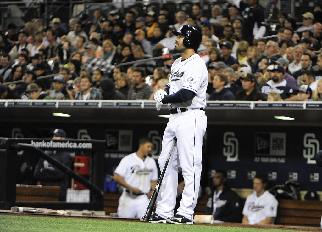 . SAN DIEGO, CA - APRIL 12:  Carlos Quentin #18 of the San Diego Padres waits before batting in the first inning against the Colorado Rockies at Petco Park on April 12, 2013 in San Diego, California.  (Photo by Denis Poroy/Getty Images)