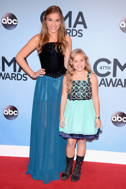. NASHVILLE, TN - NOVEMBER 06:  Actresses Lennon Stella and Maisy Stella attend the 47th annual CMA Awards at the Bridgestone Arena on November 6, 2013 in Nashville, Tennessee.  (Photo by Michael Loccisano/Getty Images)