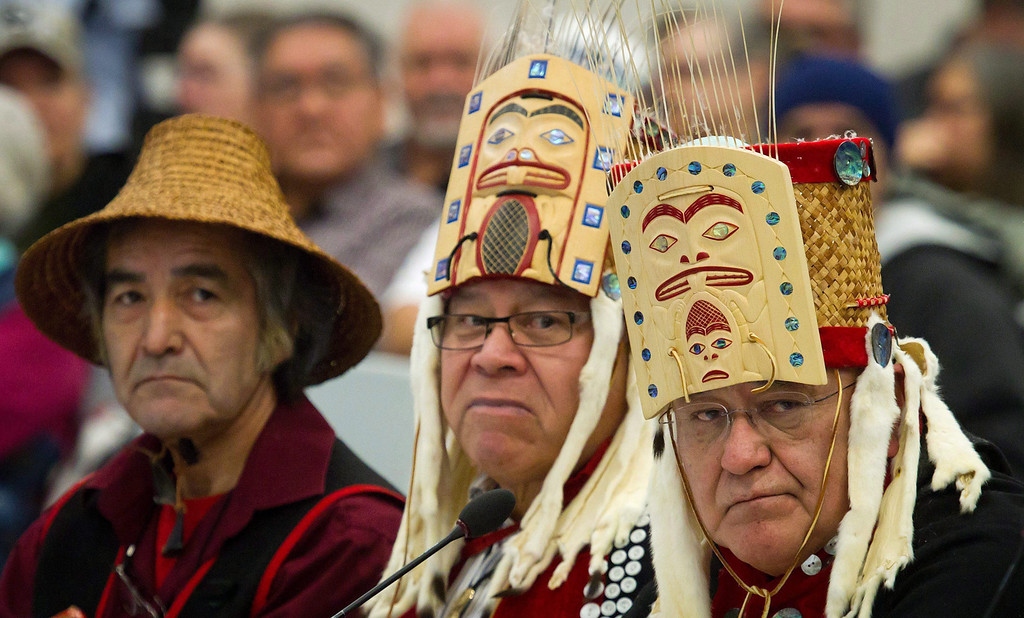 . Haisla First Nation Hereditary Chiefs Clifford Smith, from left, Rod Bolton and Sam Robinson look on while addressing the panel during the opening day of hearings for the Enbridge Northern Gateway Project in Kitimaat Village, B.C., on Jan.  10, 2012.    (AP Photo/The Canadian Press, Darryl Dyck)