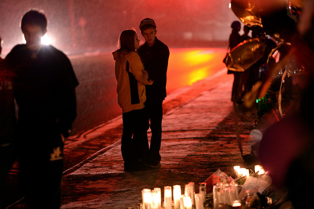 . CENTENNIAL, CO. - DECEMBER 21:   Brandon Groberts and Bri Vahle stood in the snow looking at the memorial to Claire Davis Saturday night. A steady stream of people payed their respects at the fence outside Arapahoe High School as news spread that Claire Davis passed away Saturday night, December 21, 2013. Photo By Karl Gehring/The Denver Post