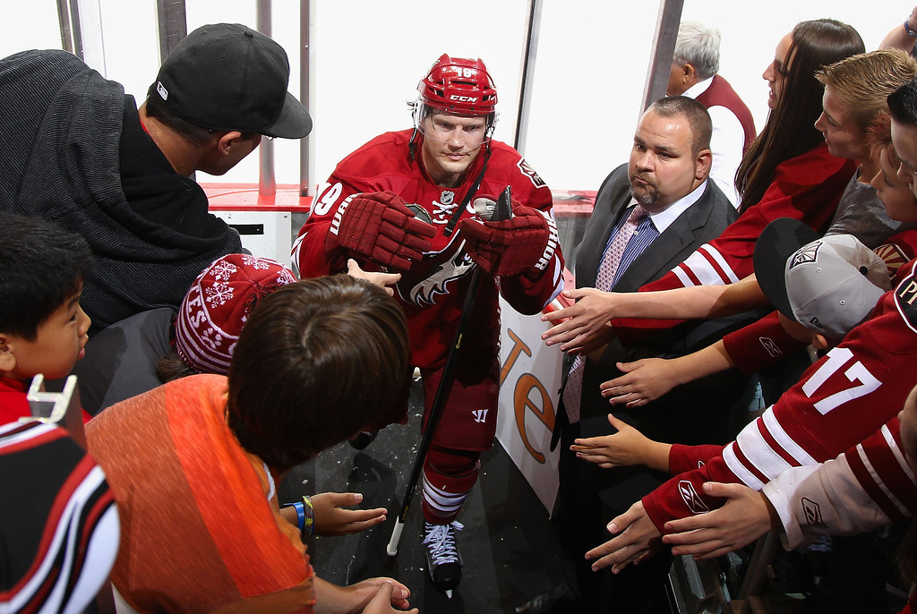 . GLENDALE, AZ - APRIL 26:  Shane Doan #19 of the Phoenix Coyotes is greeted by fans as he skates off the ice following the NHL game against the Colorado Avalanche at Jobing.com Arena on April 26, 2013 in Glendale, Arizona.  The Avalanche defeated the Coyotes 5-4 in an overtime shoot-out. (Photo by Christian Petersen/Getty Images)