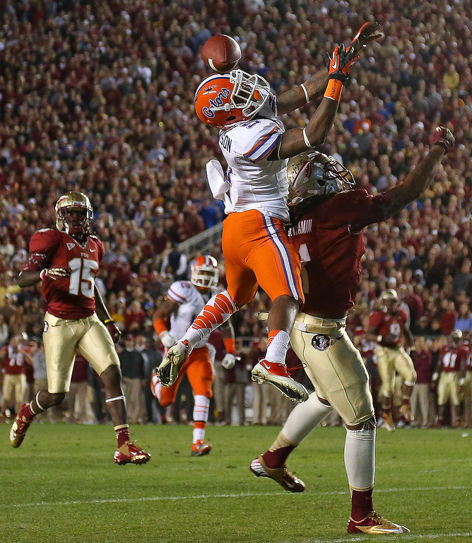 . Marcus Roberson #5 of the Florida Gators goes up for an interception during a game against the Florida State Seminoles at Doak Campbell Stadium on November 24, 2012 in Tallahassee, Florida.  (Photo by Mike Ehrmann/Getty Images)