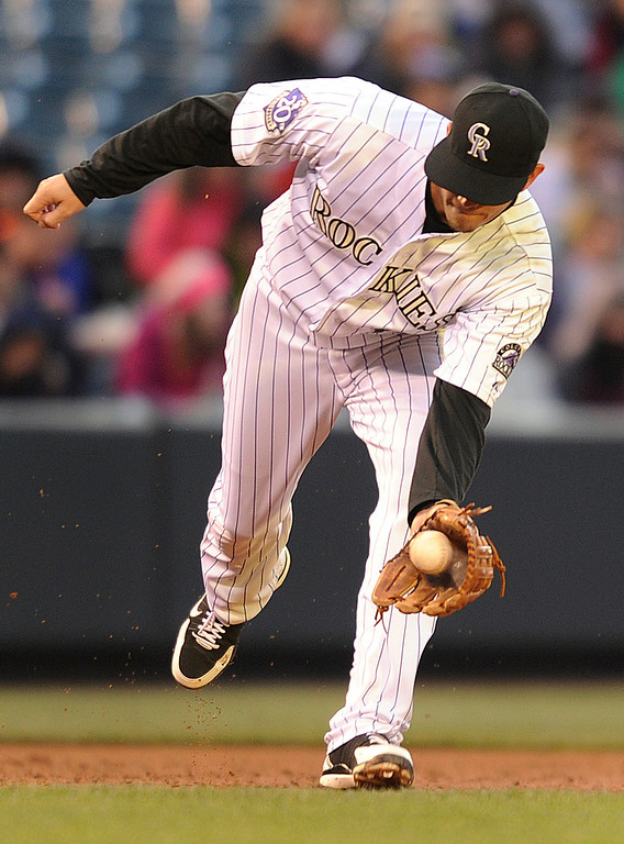 . DENVER, CO. - APRIL 23:  Rockies 3B Reid Brignac gobbled up a ground ball off the bat of B.J.Upton in the  third inning. The Colorado Rockies hosted the Atlanta Braves in the second game of a doubleheader Tuesday night April 23, 2013 at Coors Field. Photo By Karl Gehring/The Denver Post