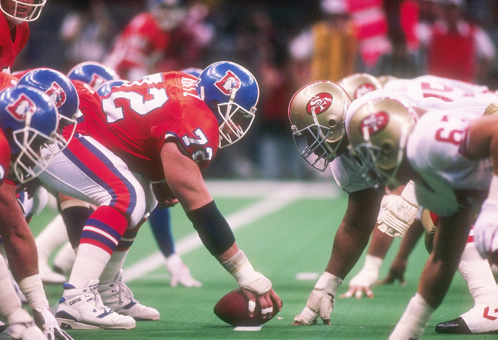 . Center Keith Kartz #72 of the Denver Broncos faces off against the defensive line and  Michael Carter (right) of the San Francisco 49ers during the Super Bowl XXIV game at the Louisiana Superdome in New Orleans, Louisiana.  (Rick Stewart/Allsport)