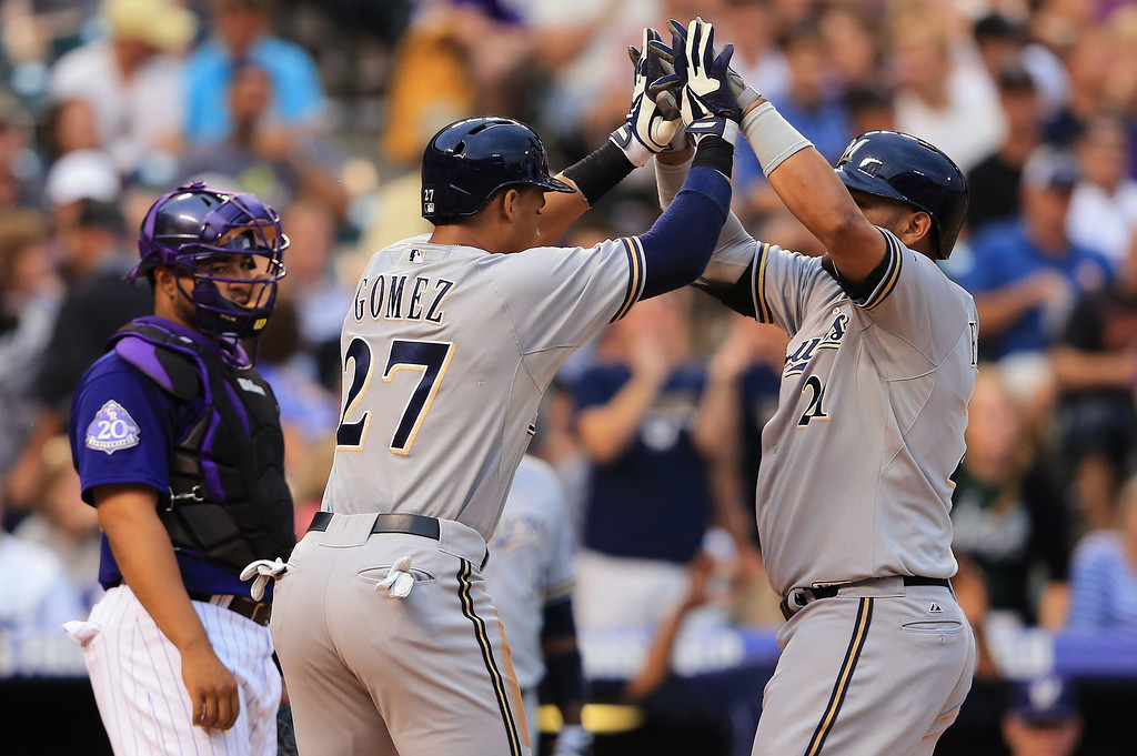 . DENVER, CO - JULY 27:  Juan Francisco #21 of the Milwaukee Brewers is welcomed home by Carlos Gomez #27 of the Milwaukee Brewers on his two run home run off of starting pitcher Collin McHugh #43 of the Colorado Rockies in the third inning at Coors Field on July 27, 2013 in Denver, Colorado.  (Photo by Doug Pensinger/Getty Images)