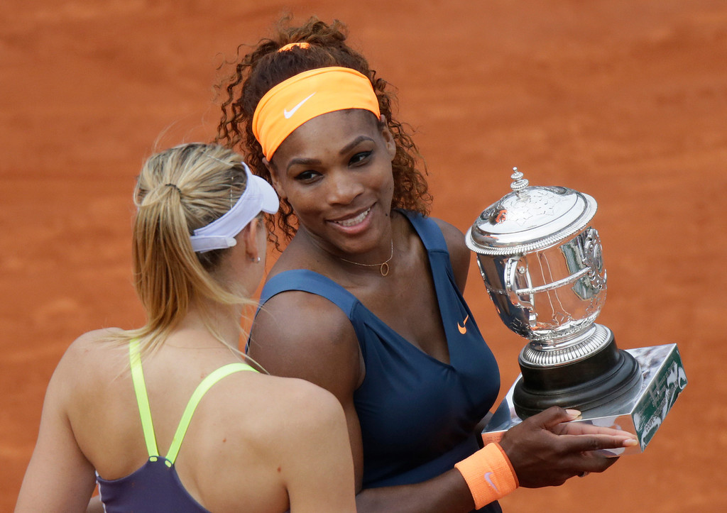 . USA\'s Serena Williams (R), holding the Suzanne-Lenglen trophy, speaks with Russia\'s Maria Sharapova after their 2013 French tennis Open final at the Roland Garros stadium in Paris on June 8, 2013. Williams won the tournament.  AFP PHOTO / KENZO  TRIBOUILLARD/AFP/Getty Images