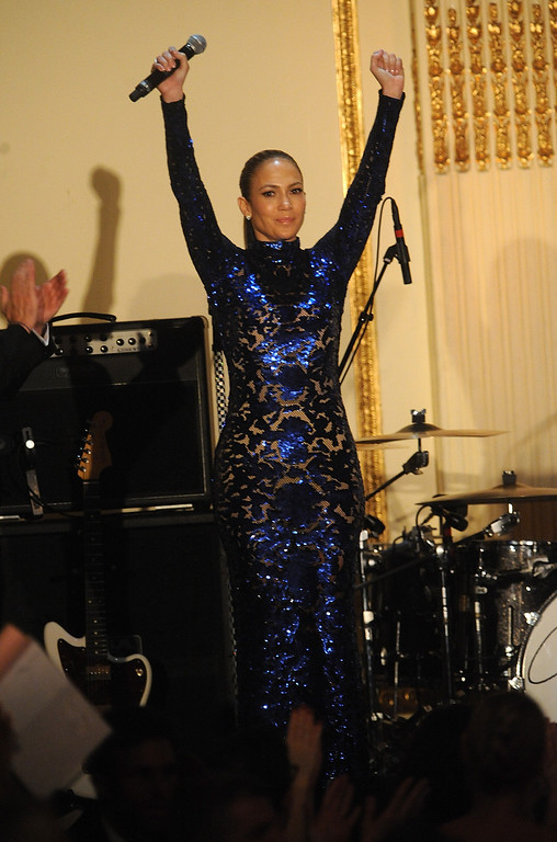 . Actress Jennifer Lopez reacts after selling a date during a silent auction at the amfAR Inspiration Gala at the The Plaza Hotel on Thursday, June 13, 2013 in New York. (Photo by Brad Barketv/Invision/AP)