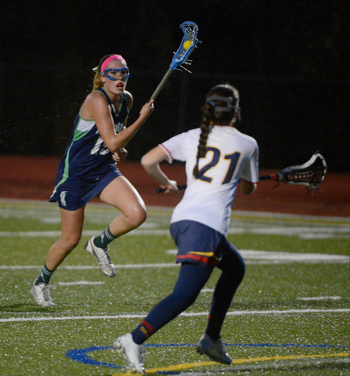 . LITTLETON, CO - MAY 8: Brianna LeCompte, left, ThunderRidge High School, finds open running room against Natasha Liggett, Heritage/Littleton, during the second half of play at Littleton Public Schools Stadium for the first round of the 2013 Colorado Girls State Lacrosse Championships May 8, 2013. ThunderRidge won 8-5. (Photo By Andy Cross/The Denver Post)