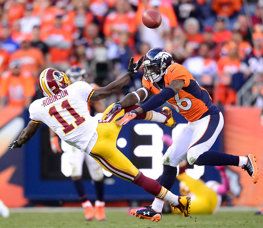 . Denver Broncos cornerback Kayvon Webster (36) breaks up a pass to Washington Redskins wide receiver Aldrick Robinson (11) on third down in the third quarter.  (Photo by AAron Ontiveroz/The Denver Post)