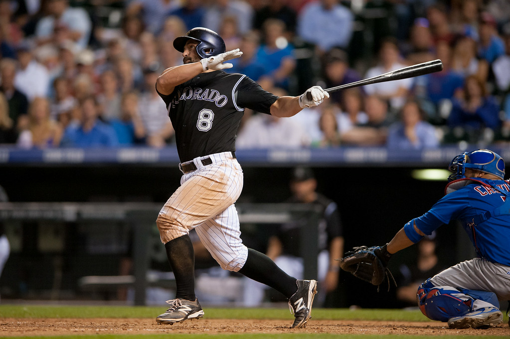 . DENVER, CO - AUGUST 06:  Michael McKenry #8 of the Colorado Rockies hits a 2-run home run in the seventh inning of a game against the Chicago Cubs at Coors Field on August 6, 2014 in Denver, Colorado.  (Photo by Dustin Bradford/Getty Images)