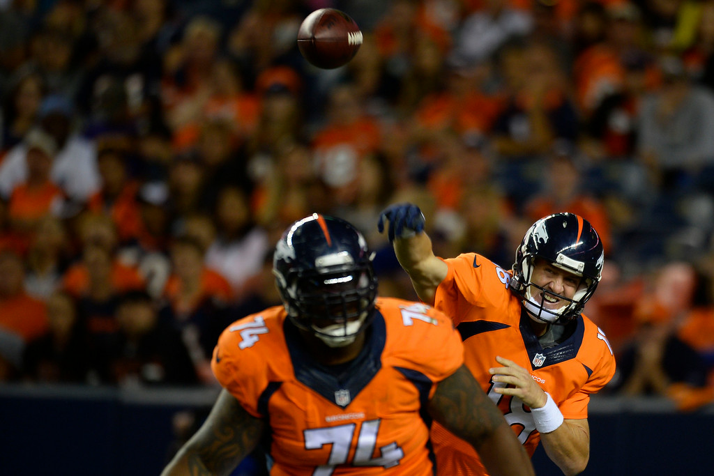 . DENVER, CO - AUGUST 23: Peyton Manning (18) of the Denver Broncos passes against the Houston Texans during a preseason football game at Sports Authority Field at Mile High on Saturday, August 23, 2014 in Denver, Colorado.  (Photo by Kent Nishimura/The Denver Post)