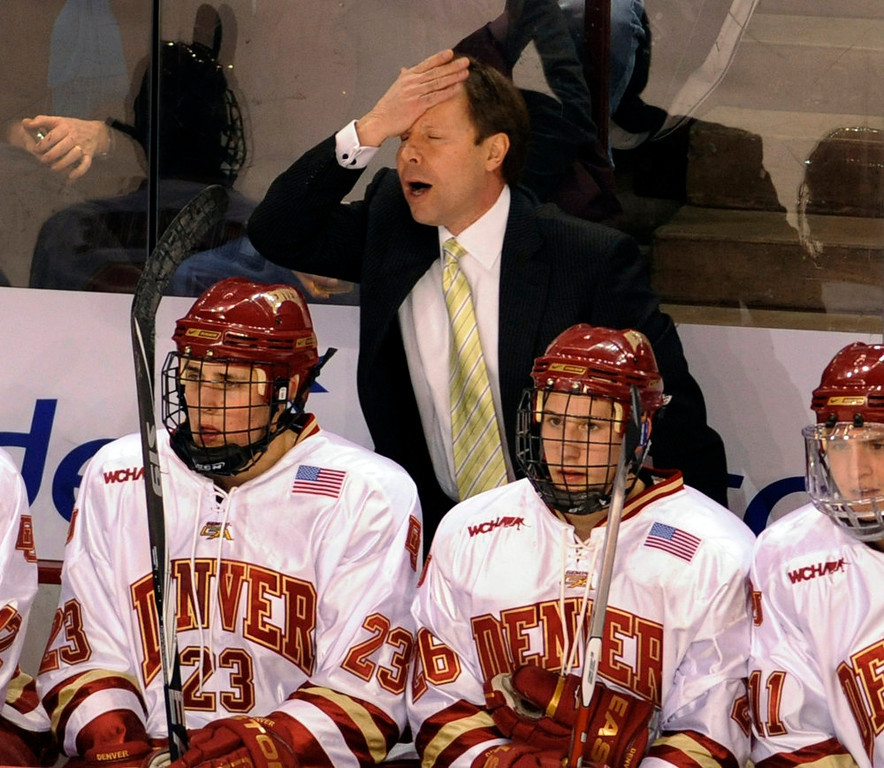 . Denver coach George Gwozdecky reacted to a call by a referee in the first period.  The Denver Pioneers hockey team hosted the Minnesota Gophers Friday night, February 12, 2010 at Magness Arena.     Karl Gehring, The Denver Post