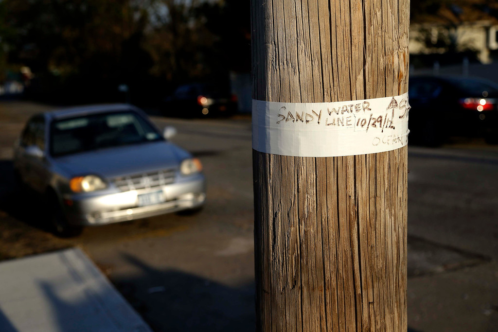 . Tape on a telephone pole marks the water level during Superstorm Sandy in the Ocean Breeze section of Staten Island, New York, Tuesday, Oct. 29, 2013.  (AP Photo/Seth Wenig)