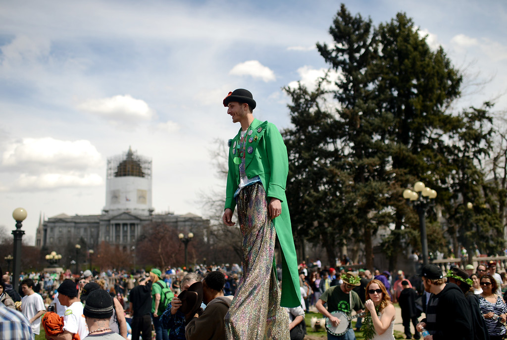 . DENVER, CO. - APRIL 20 : Todd Jacko of Denver, front, and a crowd of marijuana smokers gathered at the park to mark the counterculture holiday known as 4/20 on the first celebration since Colorado and Washington made pot legal for recreation use. (Photo By Hyoung Chang/The Denver Post)