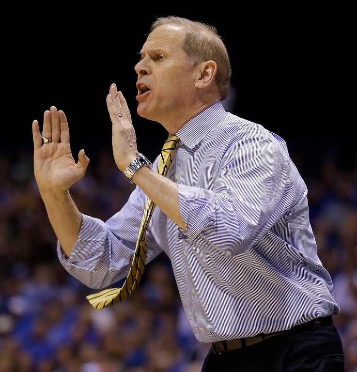 . Michigan head coach John Beilein yells to his players during the first half of an NCAA Midwest Regional final college basketball tournament game against Kentucky Sunday, March 30, 2014, in Indianapolis. (AP Photo/Michael Conroy)