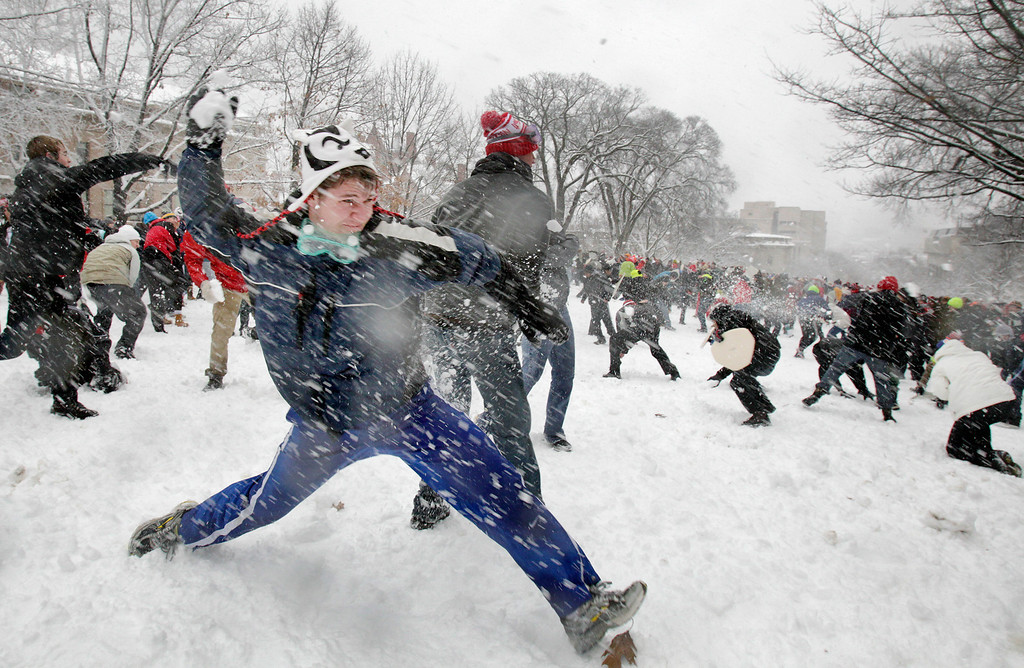 . A snow fight ensues among University of Wisconsin-Madison students on Bascom Hill in Madison, Wis., Thursday afternoon, Dec. 20, 2012. (AP Photo/Wisconsin State Journal, M.P. King)