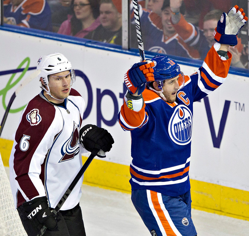 . Colorado Avalanche\'s Erik Johnson (6) stands by as Edmonton Oilers\' Shawn Horcoff celebrates his goal during the second period of their NHL hockey game, Monday, Jan. 28, 2013, in Edmonton, Alberta. (AP Photo/The Canadian Press, Jason Franson)