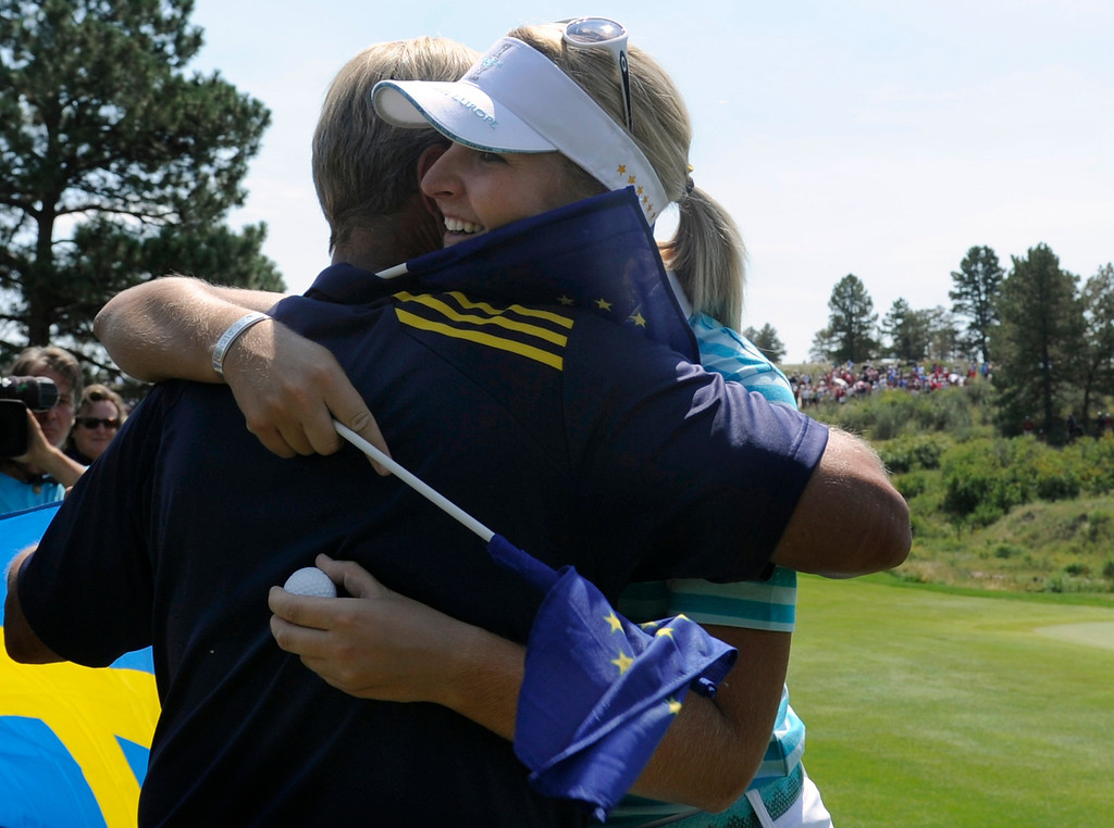 . PARKER, CO - Aug.17: Team Europe\'s Anna Nordqvist holds on tight to her hole-in-one ball as she celebrates on the 17th green.  The 2013 Solheim Cup takes place at the Colorado Golf Club with the USA taking on Europe in the Saturday morning Foursomes Match. (Photo By Kathryn Scott Osler/The Denver Post)