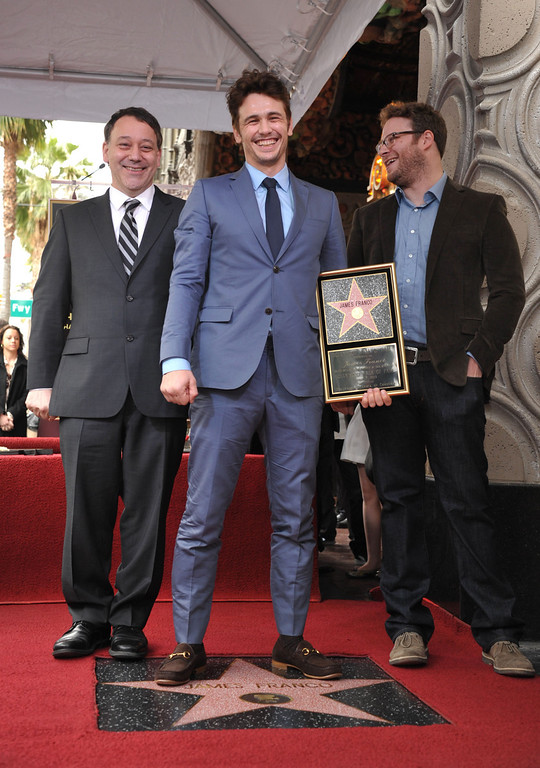 ". Director Sam Raimi, left, actor James Franco, center, and actor Seth Rogen appear at a ceremony honoring Franco with a star on the Hollywood Walk of Fame on Thursday, March 7, 2013 in Los Angeles. Franco and Rogen starred together in the comedy ""Pineapple Express,\"" and Raimi directed Franco in \""Oz the Great and Powerful.\"" (Photo by John Shearer/Invision/AP)"