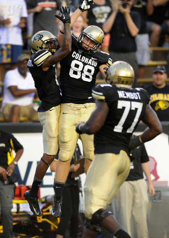 . BOULDER, CO. - SEPTEMBER 76: Buffs receiver Paul Richardson, left, celebrate a first quarter touchdown with tight end Kyle Slavin, right. The University of Colorado football team hosted Central Arkansas at Folsom Field Saturday night, September 7, 2013. Photo By Karl Gehring/The Denver Post