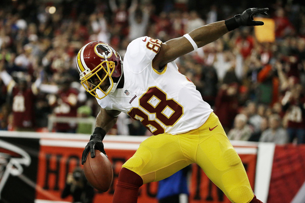 . Washington Redskins wide receiver Pierre Garcon (88) celebrates his touchdown against the Atlanta Falcons during the first half of an NFL football game, Sunday, Dec. 15, 2013, in Atlanta. (AP Photo/David Goldman)