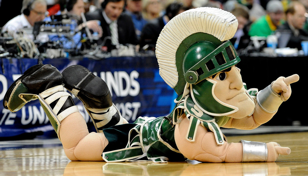 . Sparty, the Michigan State Spartans mascot, cheers on his team during their game against the Delaware Fightin Blue Hens in the second round of the 2014 NCAA Men\'s Basketball Tournament at Spokane Veterans Memorial Arena on March 20, 2014 in Spokane, Washington.  (Photo by Steve Dykes/Getty Images)